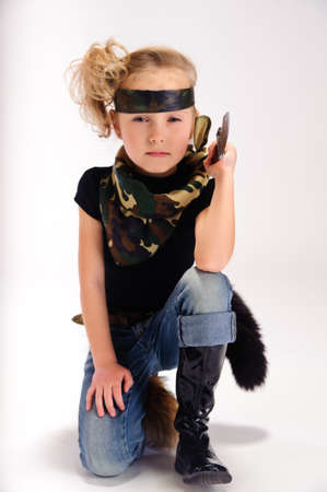 toddler girl with an army knife Stock Photo - 9045482