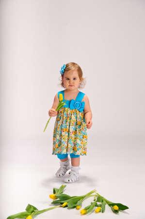 little girl and tulips Stock Photo - 9447906