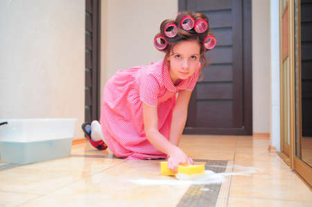 kneeled: Girl washing floor