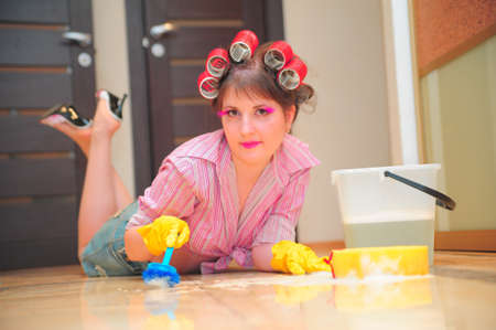 scrubbing up: Housewife washing floors Stock Photo
