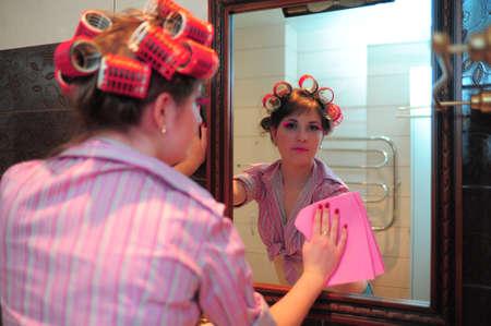 Housewife washing mirror photo
