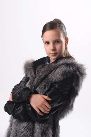 Girl in a fur coat photo