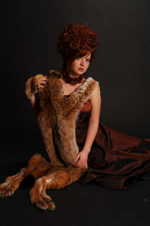 girl and a lynx pelt photo