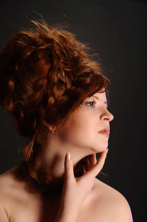 The elegant red-haired girl in studio Stock Photo - 11979488