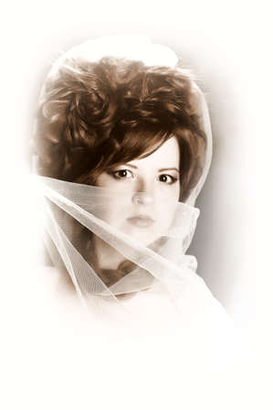 red-haired girl in a white veil photo
