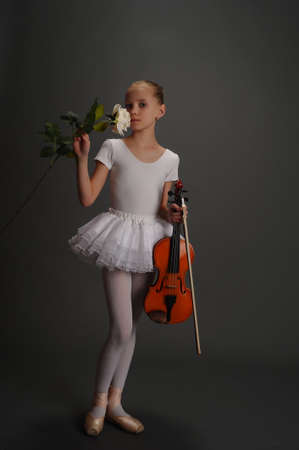 Young girl with violin photo