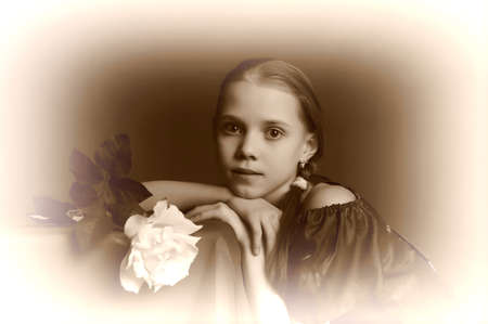 vintage portrait: thoughtful girl with a white rose Stock Photo