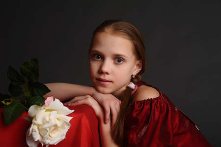 thoughtful girl with a white rose Stock Photo - 9081329