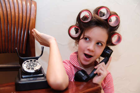 Girl chatting on a retro telephone photo