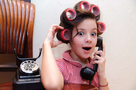 Girl chatting on a retro telephone Stock Photo - 9216093