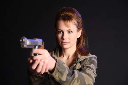 Young military gun woman Stock Photo - 9215768