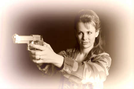 Young military gun woman Stock Photo - 9215751