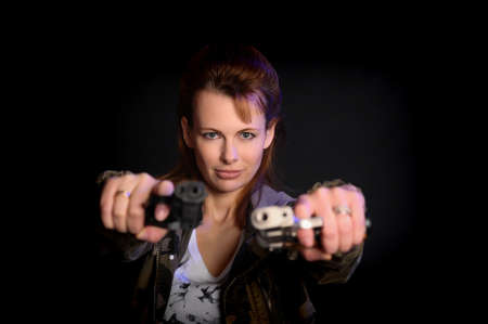Young woman with guns photo