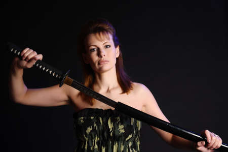Military girl with a katana photo