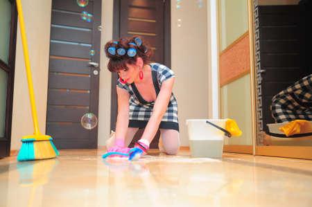 Housewife washing floors photo