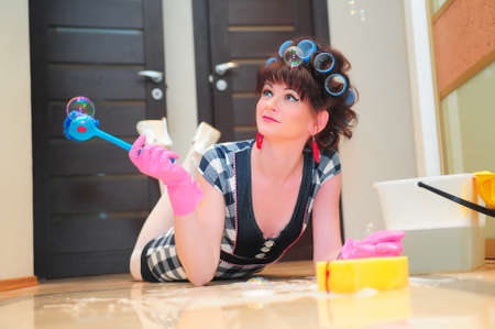 Housewife washing floors photo