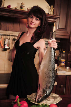 housewife holding a fish photo