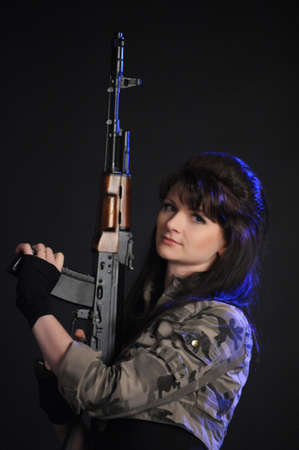 Young and sexy woman holding a rifle Stock Photo - 9216046