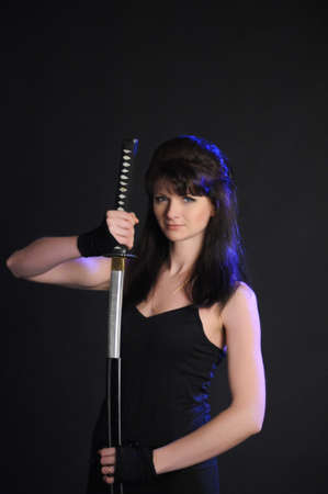 girl with a katana on a black background photo