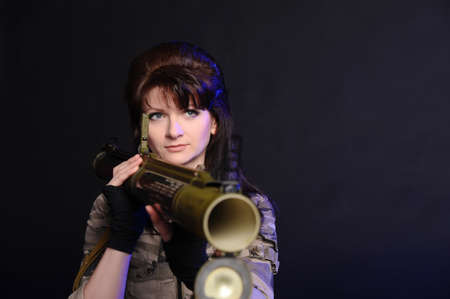 extremist: girl with a grenade launcher on a black background