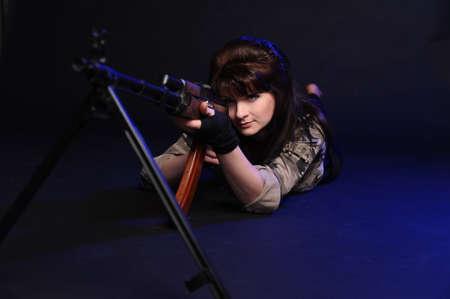 armed girl photo