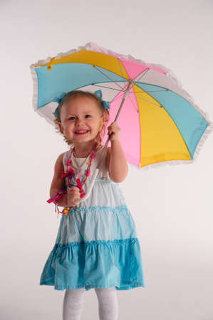 little blonde girl: little girl with umbrella