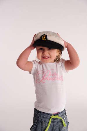 Little girl in a captain s cap  Stock Photo - 13215966