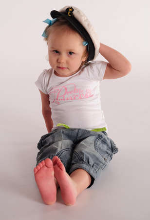 Little girl in a captain s cap  photo