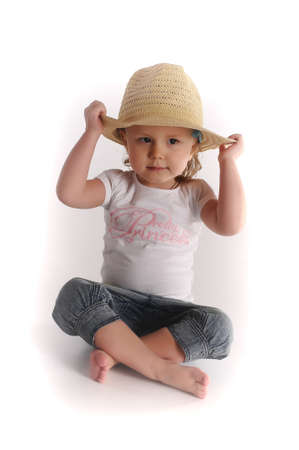 Little girl in a straw hat photo