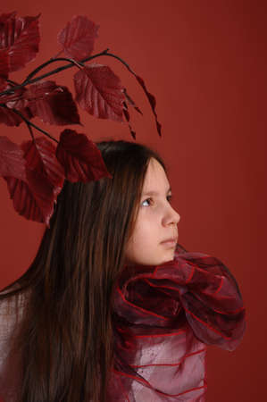 girl wearing a scarf with autumn leaves  photo
