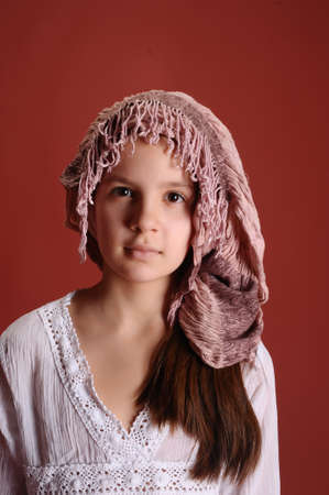 The girl in a medieval hat Stock Photo
