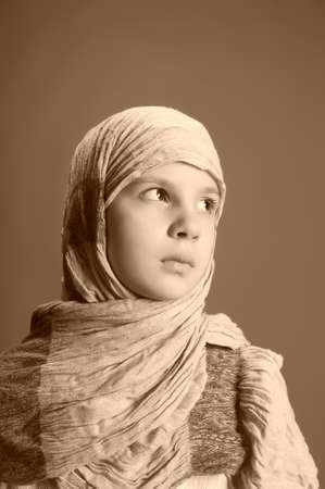 Muslim girl in a headscarf photo