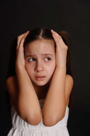 frightened girl on a black background Stock Photo - 9359703