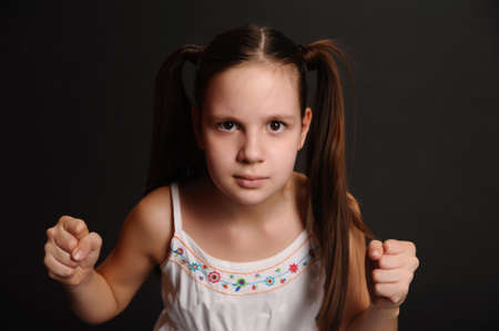 angry girl on a black background Stock Photo - 9723184