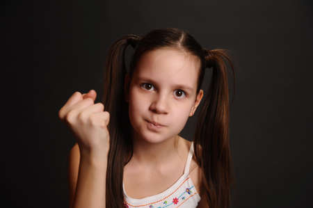 pouty: The girl the teenager is angry Stock Photo
