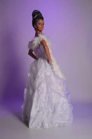 woman in a white dress and boa photo