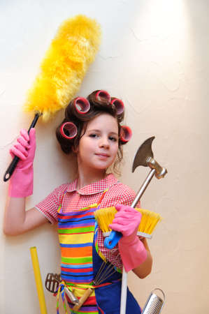 looking for work: a young housewife with brushes and rollers