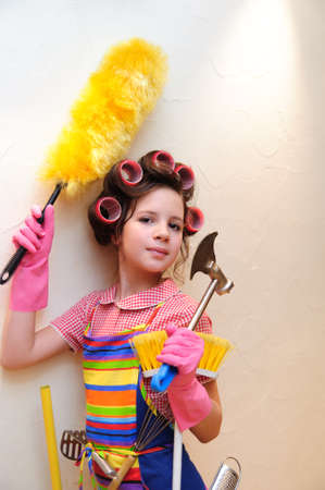 a young housewife with brushes and rollers Stock Photo - 11515414
