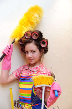 a young housewife with brushes and rollers Stock Photo - 11515416