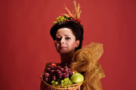 woman with a basket of fruit photo