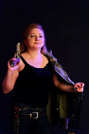 middle-aged woman with a gun Stock Photo - 9400161
