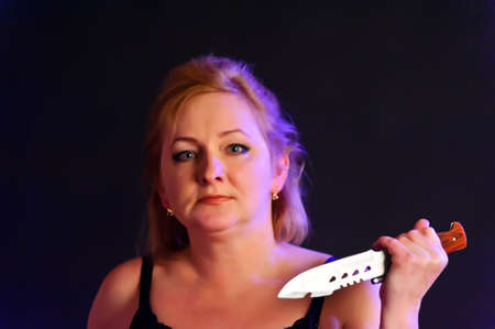 middle-aged woman with a knife photo