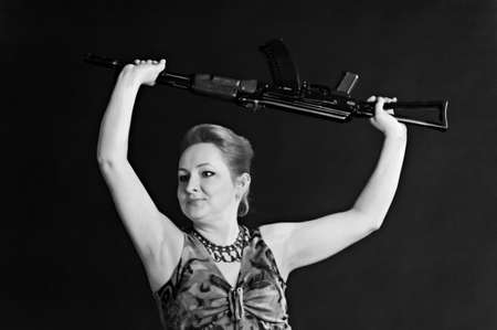 middle-aged woman with a gun Stock Photo - 10833562