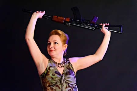 middle-aged woman with a gun Stock Photo - 10833564
