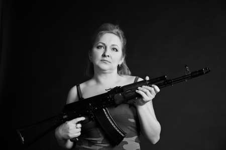 middle-aged woman with a gun Stock Photo - 10833260