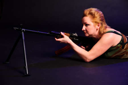middle-aged woman with a gun Stock Photo - 10833273