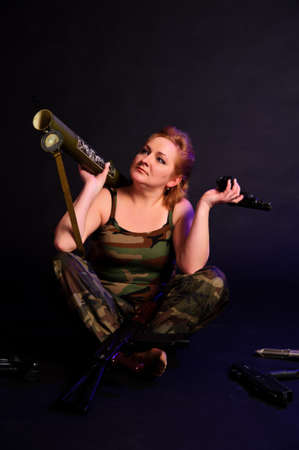 Woman with a gun photo