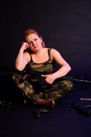 middle-aged woman with a gun Stock Photo - 10833269