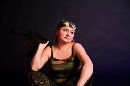 beautifu: middle-aged woman with a gun Stock Photo