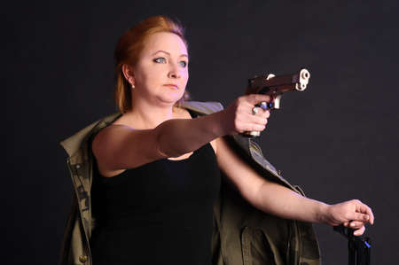 middle-aged woman with a gun Stock Photo - 10833516